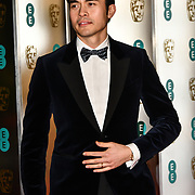 Henry Golding Arrivers at EE British Academy Film Awards in 2019 after-party dinner at Grosvenor house on 10 Feb 2019.