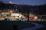 The evening rush hour increases the amount of traffic passing through the road junction at Herne Hill, SE24, in south London, on 21st January 2021, in London, England. Herne Hill is located betwen Brixton, Dulwich Village and Camberwell and lies over the shared London boroughs of Lambeth and Southwark with a community of approximately 15,000.