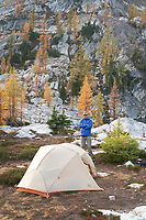 Adult male in blue jacket at Stiletto Lake backcountry camp, North Cascades National Park Washington