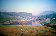 Countryside area with forested hills and lake seen on rail journey from Sao Paulo to  Campinas, Brazil, South America 1962