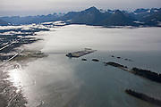 Aerial view of Port Valdez, Alaska, covered in a morning marine fog layer.