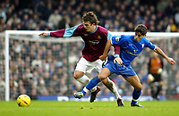 Photo. Chris Ratcliffe<br /> West Ham United v Ipswich Town. Nationwide 1st Division 26/12/2003<br /> Michael Carric of West Ham tussles with double goal scorer Pablo Counago at West Ham