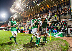 Hibernian's Liam Craig celebrates after scoring their second goal, with Hibernian's team mates in front of the fans.<br /> Dundee United 2 v 2 Hibernian, Scottish Premiership game today at Tanadice.