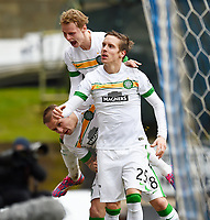 14/02/15 SCOTTISH PREMIERSHIP<br /> ST JOHNSTONE v CELTIC<br /> MCDIARMID PARK - PERTH<br /> Celtic's Stefan Johansen (right) celebrates with team-mates Gary Mackay-Steven (centre) and Leigh Griffiths after scoring his side's second goal