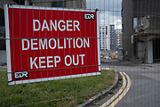 Danger demolition keep out sign on 3rd August 2021 in Birmingham, United Kingdom. The city is under a long term and major redevelopment, with much of its industrial past being demolished and made into new flats for residential homes, as part of the Big City Plan.