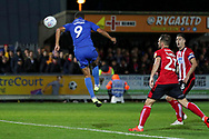 AFC Wimbledon striker Kweshi Appiah (9) scoring goal to make it 1-1 during the EFL Sky Bet League 1 match between AFC Wimbledon and Lincoln City at the Cherry Red Records Stadium, Kingston, England on 2 November 2019.