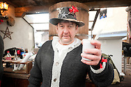 Imst Schemenlaufen, a traditional carnival held only once every four years in Imst, Tirol, Austria (31 January 2016). The Schemenlaufen is inscribed on the UNESCO list of Intangible Cultural Heritage. Pictured, serving mulled wine (here called hexenblut or 'witches' blood'). © Rudolf Abraham