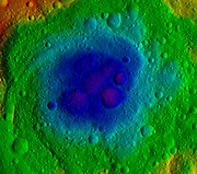 This image from NASA's Dawn mission shows the topography of the northern and southern hemispheres of the giant asteroid Vesta, updated with pictures obtained during Dawn's last look back. Around the time of Dawn's departure from Vesta in the late summer of 2012, dawn was beginning to creep over the high northern latitudes, which were dark when Dawn arrived in the summer of 2011. The three craters that make up Dawn's 'snowman' feature can be seen at the top of the northern hemisphere map on the left. A mountain more than twice the height of Mount Everest, inside the largest impact basin on Vesta, can be seen near the center of the southern hemisphere map on the right.