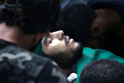 August 3, 2017 - Kulgam, Jammu and Kashmir, India - (EDITORS NOTE: Image depicts death) People surround near the dead body of of a slain Kashmiri Young Rebel Aaquib Hamid Itoo  at Gopalpora village of Kulgam District, 80 Km from Srinagar, Itoo was killed along with Another associate Suhail Ah in a gunfight with forces in Kulgam. (Credit Image: © Muneeb Ul Islam/Pacific Press via ZUMA Wire)