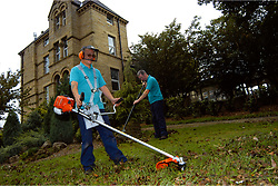 Grass strimming grounds maintenance at NHS hospital Yorkshire UK