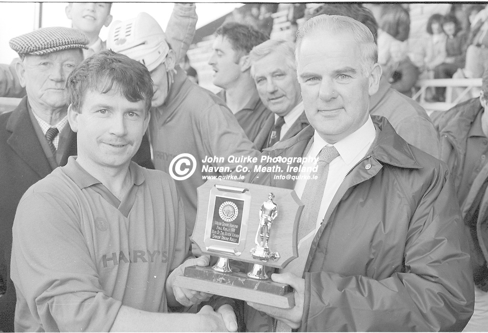 """01-12-91. Killyon v Trim - Meath SHC Final at Pairc Tailteann.<br /> Paddy Quinn receiving the """"Man of the Match"""" award sponsored by Dominic Reilly from <br /> Photo: John Quirke / www.quirke.ie<br /> ©John Quirke Photography, 16 Proudstown Road, Navan. Co. Meath. (info@quirke.ie / 046-9028461 / 087-2579454)."""