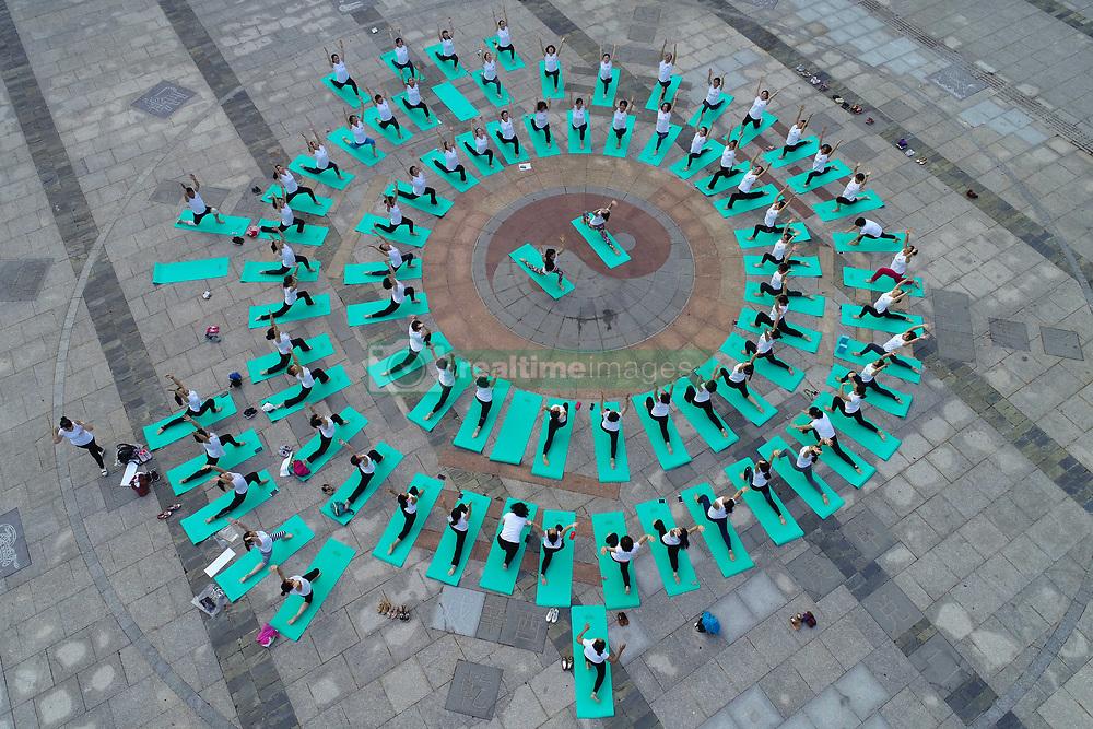 June 21, 2018 - Huai'An, Huai'an, China - Huai'an, CHINA-21st June 2018: People practice yoga at Bochi Hill Park in Huai'an, east China's Jiangsu Province, marking International Yoga Day. (Credit Image: © SIPA Asia via ZUMA Wire)