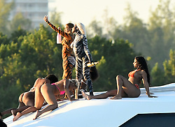 EXCLUSIVE: Rapper Cardi B. wears body paint and pours champagne on dancers on a yacht during a video shoot in Miami. 03 Dec 2018 Pictured: Cardi B. Photo credit: MEGA TheMegaAgency.com +1 888 505 6342