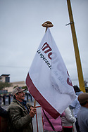 A supporter of AMLO put a piece of bred on his flag, to represent that Morena can bring back bred to poor people in Mexico.