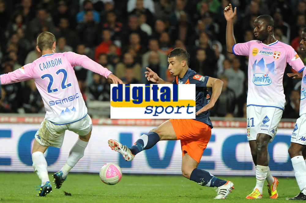FOOTBALL - FRENCH CHAMPIONSHIP 2011/2012 - L1 - MONTPELLIER HSC v EVIAN TG - 1/05/2012 - PHOTO SYLVAIN THOMAS / DPPI - YOUNES BELHANDA (MHSC) / CEDRIC CAMBON (EVI)