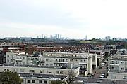 Uitzicht over Duindorp met op de achtergrond de skyline van Den Haag - View over a quarter of The Hague called Duindorp with the skyline of The Hague on the background