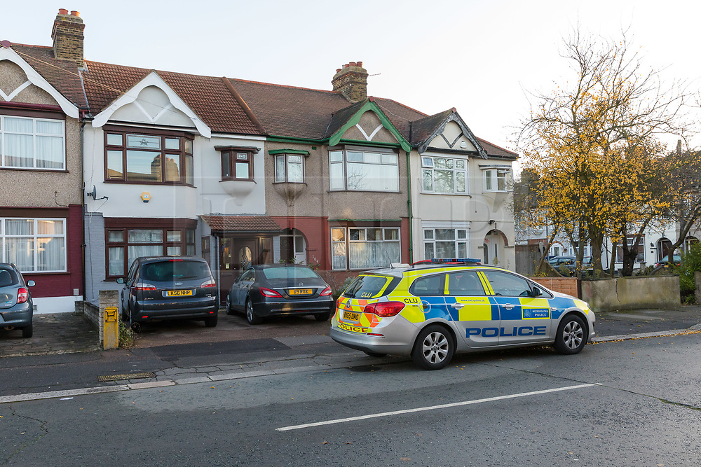 © Licensed to London News Pictures. 13/11/2018. London, UK.  A police car outside a house in Applegarth Drive, Ilford where a murder investigation has been launched in Redbridge following the death of a 35 year old woman. Police were called at approximately 07:40hrs on Monday 12th November to reports of a disturbance at an address in Applegarth Drive, Ilford where police and ambulance services attended and found a 35-year-old woman suffering an abdominal wound/injury who was taken to an east London hospital, where she was sadly pronounced dead at 11am. A 50-year-old man was arrested at the scene on suspicion of attempted murder and taken to an east London police station where he was subsequently further arrested for murder..  Photo credit: Vickie Flores/LNP