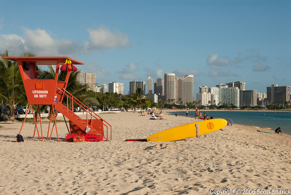 Alifeguard stand a rescue surf board sit waiting at Ala Moana Beach Park in Honolulu, Hawaii