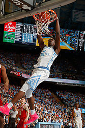CHAPEL HILL, NC - FEBRUARY 05: Nassir Little #5 of the North Carolina Tar Heels dunks the ball during a game against the North Carolina State Wolfpack on February 05, 2019 at the Dean Smith Center in Chapel Hill, North Carolina. North Carolina won 113-96. North Carolina wore retro uniforms to honor the 50th anniversary of the 1967-69 team. (Photo by Peyton Williams/UNC/Getty Images) *** Local Caption *** Nassir Little