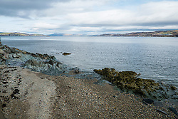 The shingle beach at Dunoon East Bay looking out over the Firth of Clyde<br /> <br /> 04 April  2015<br /> Image © Paul David Drabble <br /> www.pauldaviddrabble.co.uk