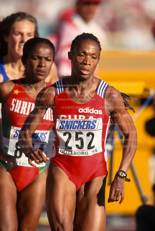 GOTHENBURG, SWEDEN -  AUGUST 11:  Ana Fidelia Quirot #252 of Cuba runs in a semi final of the Women's 800 meter event during the 1995 IAAF World Championships on August 11, 1995 at Ullevi Stadium in Gothenburg, Sweden.  Quirot was the gold medalist in the event.  Behind Quirot is Letitia Vriesde #844 of Surinam.  Photo by David Madison/Getty Images)