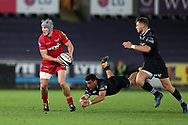 Jonathan Davies  of the Scarlets gets past a tackle from Kieron Fonotia of the Ospreys ®. Guinness Pro14 rugby match, Ospreys v Scarlets at the Liberty Stadium in Swansea, South Wales on Saturday October 7th 2017. <br /> pic by Andrew Orchard, Andrew Orchard sports photography.