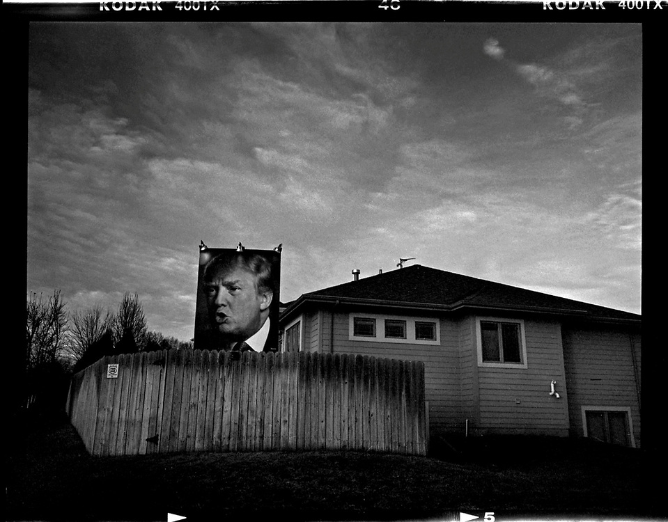 A giant poster of U.S. Republican presidential candidate Donald Trump hangs outside a house in West Des Moines, Iowa, January 15, 2016. © Photo by Jim Young