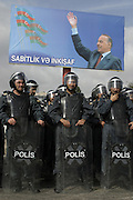 Baku, Azerbaijan, 12/10/2003..Riot police stand under a poster of President Heydar Aliyev while watching a campaign rally in support of opposition leader Isa Gambar.............