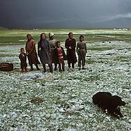 Mongolia. horsemen. A ger camp after a hailstorm.. Life comes back to normal after the astorm.  The men go out to check on the animals.  In the foreground is a wooden wheel of days gone by, (Darqan Uul, in the aymag of Arqangay.  / cavaliers, Campement de yourtes, après une tempête de grêle.  (Sum de Darqan Uul, Mongolie) Après la tempête, la vie reprend et les éleveurs sortent pour aller voir le bétail. Devant, le châssis de roue en bois d'un autre âge (dans l'aymag de ARQANGAY,   101       P0000746