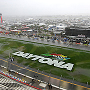 Rain falls and causes the front stretch infield to flood during the 56th Annual NASCAR Daytona 500 practice session at Daytona International Speedway on Saturday, February 22, 2014 in Daytona Beach, Florida.  (AP Photo/Alex Menendez)