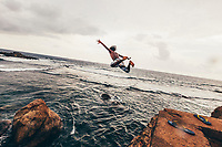 A young man jumps off the fort walls of Galle, into the Indian Ocean in Galle, along the southern coast of Sri Lanka.