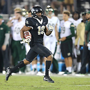UCF Knights defensive back Mike Hughes (19) runs the ball during a NCAA football game between the University of South Florida Bulls and the UCF Knights at Spectrum Stadium on Friday, November 24, 2017 in Orlando, Florida. (Alex Menendez via AP)