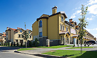 """Residential real estate """"Italian District"""" on sale. Exterior daylight view onto townhouses and sales office. Kyiv, Ukraine."""