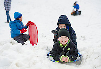 Elijah and Cole look forward to the snow storm predicted for tomorrow for more sledding at the Memorial sledding hill on Wednesday afternoon.  (Karen Bobotas/for the Laconia Daily Sun)