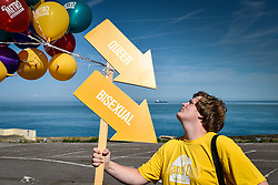 Reece from Gillingham participates in the colourful Kent Pride celebrations in the seaside town of Margate.