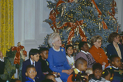 December 12, 1991 - Washington, District of Columbia, U.S - First Lady Barbara Bush hosts Christmas Party in the East Room of the White House for local school children. (Credit Image: © Mark Reinstein via ZUMA Wire)