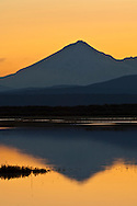 Sunset light over Mount Shasta reflected in Lower Klamath Lake, Lower Klamath National Wildlife Refuge, California