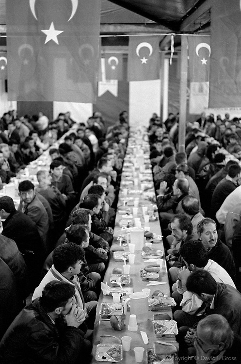 A free dinner for thousands is served in Taksim Square, Istanbul, on the first night of Ramadan, the Moslem month of fasting. Moslems do not eat from sunrise to sunset during the month of Ramadan.