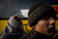 Young migrants waiting to get onboard a bus headed to a organized camp. NGOs relocated about 40 minors that decided to move to a nearby camp where they will found warm shelters, showers and medical assistance. Buses for adults are expected tomorrow. Belgrade, Serbia. January 16th, 2017. Federico Scoppa/CAPTABelgrade, Serbia. January 16th 2017. Federico Scoppa
