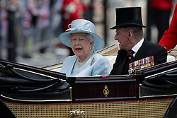 Queen Elizabeth II and The Duke of Edinburgh make their way up The Mall from Horse Guards Parade, central London to Buckingham Palace following the Trooping the Colour ceremony as the Queen celebrates her official birthday today.