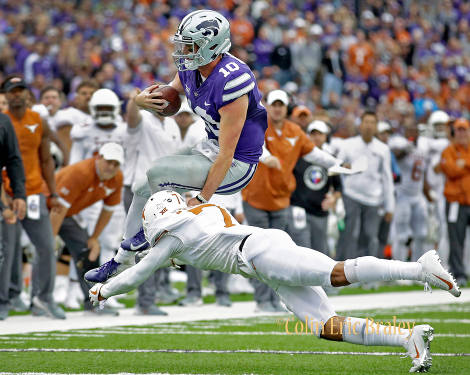 Kansas State quarterback Skylar Thompson (10) is tackled by Texas defensive back Caden Sterns (7) after scrambling for a first down in the fourth quarter of a college football game in Manhattan, Kan., Saturday, Sept. 29, 2018. (AP Photo/Colin E. Braley)