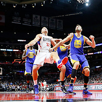 19 November 2015: Los Angeles Clippers forward Blake Griffin (32) vies for the rebound with Golden State Warriors guard Klay Thompson (11) and Golden State Warriors center Andrew Bogut (12) during the Golden State Warriors 124-117 victory over the Los Angeles Clippers, at the Staples Center, Los Angeles, California, USA.