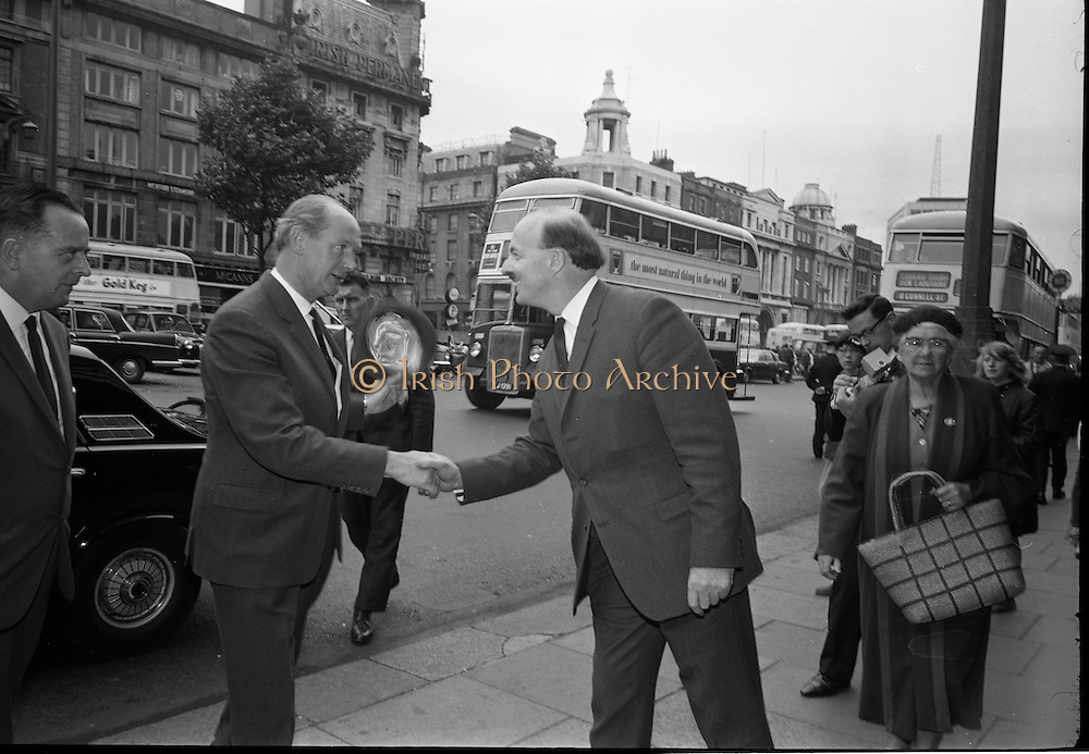 """24/07/1967<br /> 07/24/1967<br /> 24 July 1967<br /> First showing of """"Fleá Cheoil"""" at the Metropole Cinema, Dublin. A presentation was made to the director of the film Mr. Louis Marcus, for winning the Silver Bear Award at the Berlin International Film Festival, by Taoiseach Jack Lynch TD, on behalf of the Cork Film Society, where Mr. Marcus began his carrier. President of the Society Mr. Sean Hendrick attended the presentation. Image shows Taoiseach  Jack Lynch being greeted by Donal O Moráin, Ceannasai Gael-Linn, on  his arrival on O'Connell Street."""