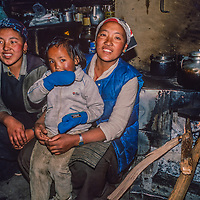 Lhakpa Doma Sherpani, her sister and daughter relax by the heath in their home in Namche Bazar, leading town of the Sherpas.