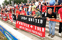Picture by Daniel Hambury.<br /> 23/07/05.<br /> AFC wimbledon v Football Club United of Manchester. Pre season friendly.<br /> Fans of FC United of Manchester, with banners and flags.
