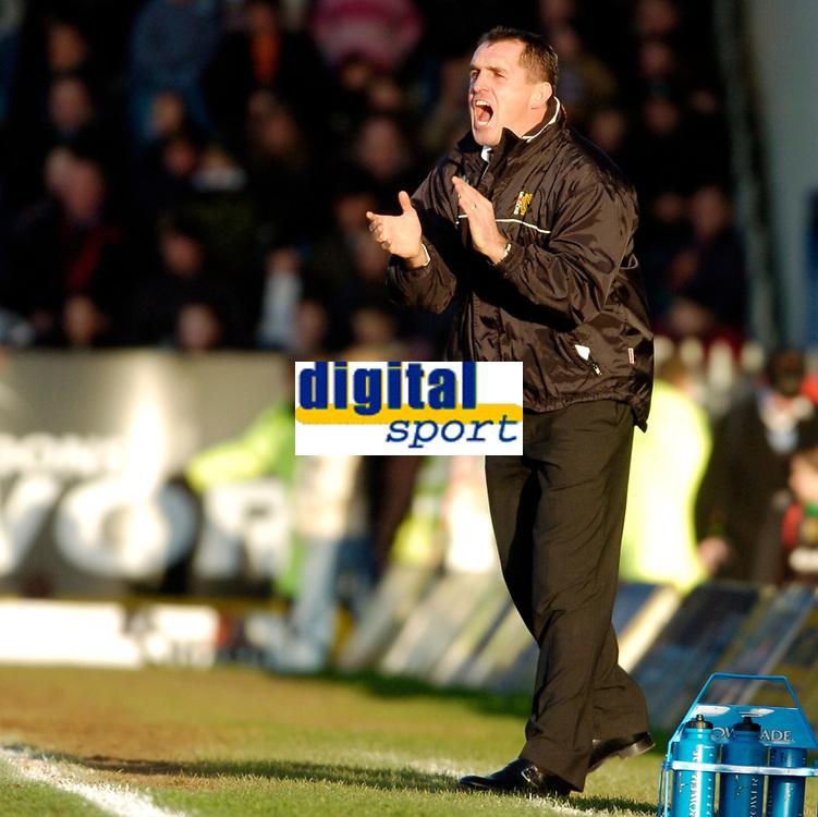Photo: Leigh Quinnell.<br /> Milton Keynes Dons v Barnet. Coca Cola League 2. 20/01/2007. MK Dons boss Martin Allen gets behind his team.
