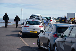 Edinburgh, Scotland, UK. 31 March, 2020. Police patrol public parks and walking areas to enforce the coronavirus lockdown regulations about being outdoor. Many cars parked at Marine Drive as police patrol area. Iain Masterton/Alamy Live News