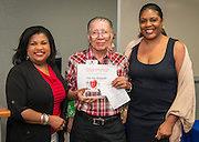 Joaquin Alejandro is named the Charles Harding Senior of the Year during Volunteers in Public Schools recognition ceremony, May 14, 2015.