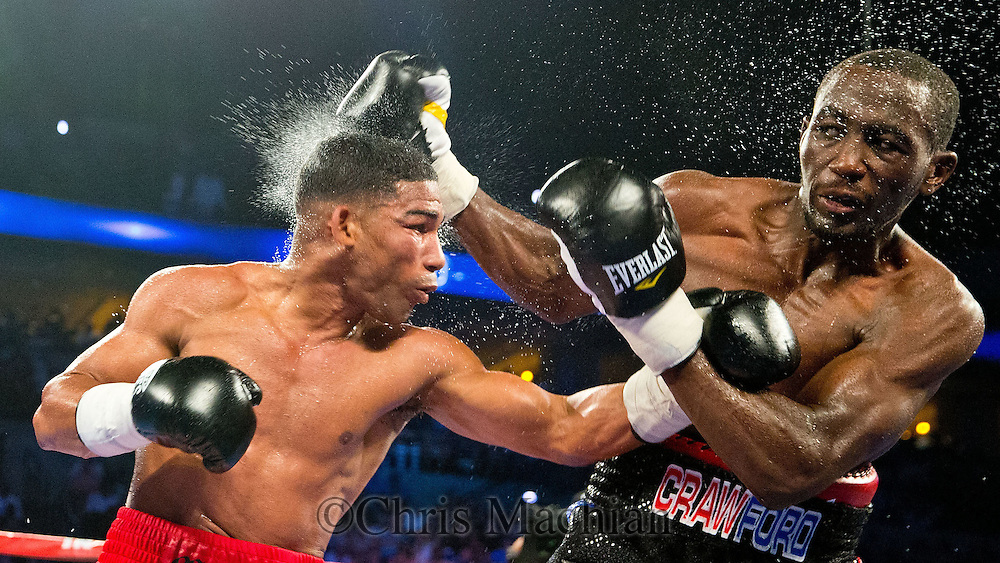 Omaha, NEB <br /> <br /> Yuriorkis Gamboa (left) and Terence Crawford (right) exchange blows in the WBO lightweight boxing title match at the CenturyLink Center in Omaha, Neb.,Omaha, Neb., Saturday, June 28, 2014. <br /> <br /> CHRIS MACHIAN/THE WORLD-HERALD