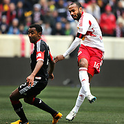 Thierry Henry, New York Red Bulls, (right), shoots past James Riley, D.C. United, during the New York Red Bulls V D.C. United, Major League Soccer regular season match at Red Bull Arena, Harrison, New Jersey. USA. 16th March 2013. Photo Tim Clayton